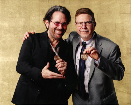Kip Winger and Paul Blakemore together at the Grammy Nominees Reception in Los Angeles on Feb. 11, 2017, proudly displaying their nominee medals.